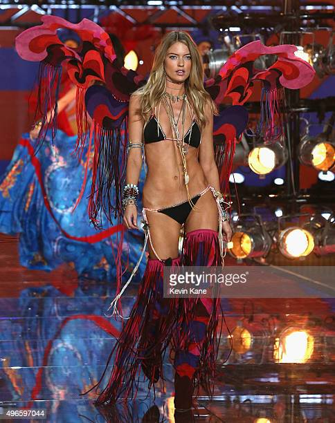 Model and New Victoria's Secret Angel Martha Hunt from North Carolina walks the runway during the 2015 Victoria's Secret Fashion Show at Lexington...