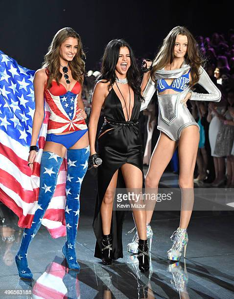Model and New Victoria's Secret Angel Taylor Hill from Illinois Selena Gomez and Model Megan Puleri from Ohio pose onstage during the 2015 Victoria's...