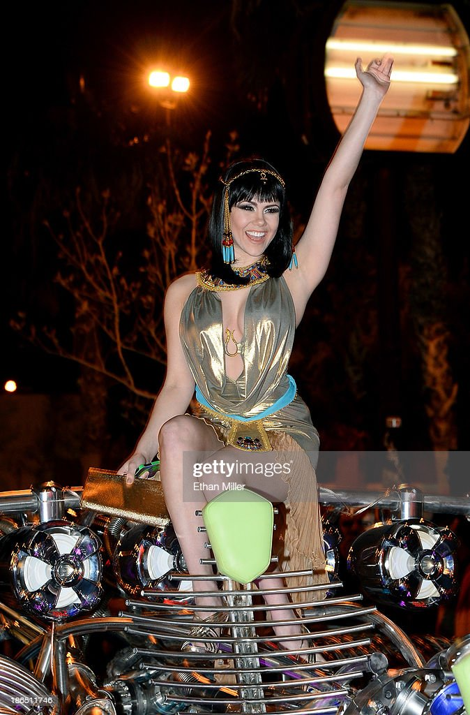 Model and parade queen <a gi-track='captionPersonalityLinkClicked' href=/galleries/search?phrase=Claire+Sinclair&family=editorial&specificpeople=6960124 ng-click='$event.stopPropagation()'>Claire Sinclair</a> rides in the MisterFusion Artcar during the fourth annual Las Vegas Halloween Parade on October 31, 2013 in Las Vegas, Nevada.