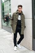Model and performer Max Jorquera wears Topman jeans Ericouture T shirt Converse trainers and Thomas Farthing jacket on day 2 of London Collections...