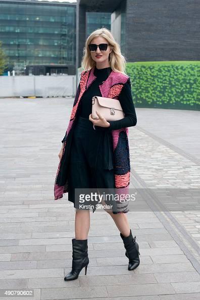 Model and Photographer Candace Lake wears a Tibi top and skirt Roksanda Ilincic jacket Tome sunglasses Jimmy Choo boots and Folli Follie bag on day 3...