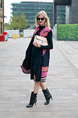 Model and Photographer Candace Lake wears a Tibi top and skirt Roksanda Ilincic jacket Tome sunglasses Jimmy Choo boots and Folli Follie bag on day 3...