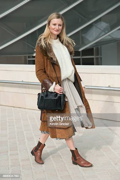 Model and photographer Candace Lake wears a vintage coat Michael Van Der Ham skirt Tibi sweater Cole Haan boots and Emm Kuo bag on day 9 of Paris...