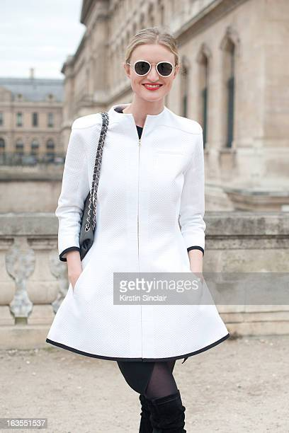 Model and photographer Candice Lake wears a Chanel bag Aganovich jacket and Raf Simons sunglasses on day 7 of Paris Womens Fashion Week Autumn/Winter...