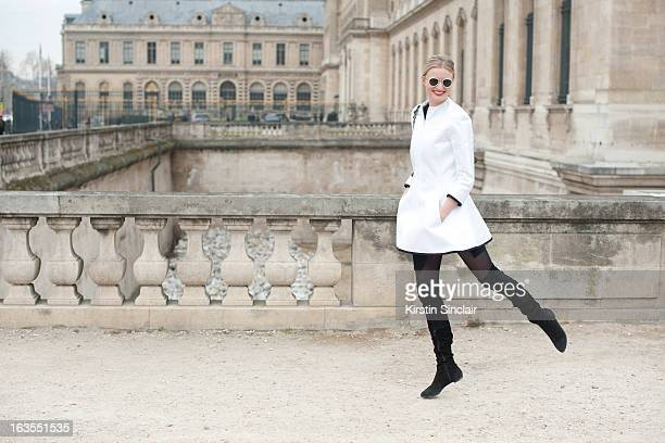 Model and photographer Candice Lake wears a Chanel bag Aganovich jacket Raf Simons sunglasses and Zara boots on day 7 of Paris Womens Fashion Week...