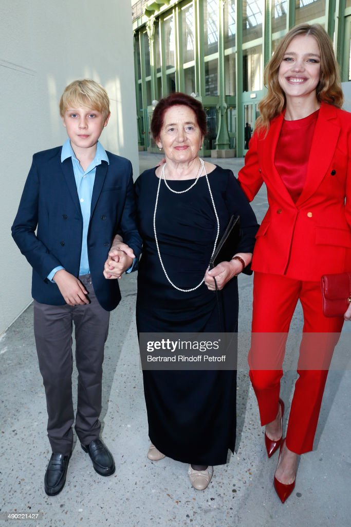 Model and President of the 'Naked Heart Foundation' <a gi-track='captionPersonalityLinkClicked' href=/galleries/search?phrase=Natalia+Vodianova&family=editorial&specificpeople=203265 ng-click='$event.stopPropagation()'>Natalia Vodianova</a> (R), her grandmother Varissa Gromova and her son Lucas Portman attend 'The strange city' Exhibition by Ilya and Emilia Kabakov at Monumenta 2014 : Dinner to benefit 'Naked Heart Foundation'. Held at Grand Palais on May 13, 2014 in Paris, France.