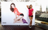 Model and Reebok Easytone Ambassador Miranda Kerr reveals a 3D image shot by Rankin during a Reebok Satisfaction photo call on the roof of the...