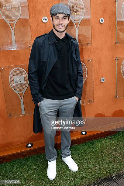 Model and singer Baptiste Giabiconi attends the Roland Garros Tennis French Open 2013 Day 15 on June 9 2013 in Paris France