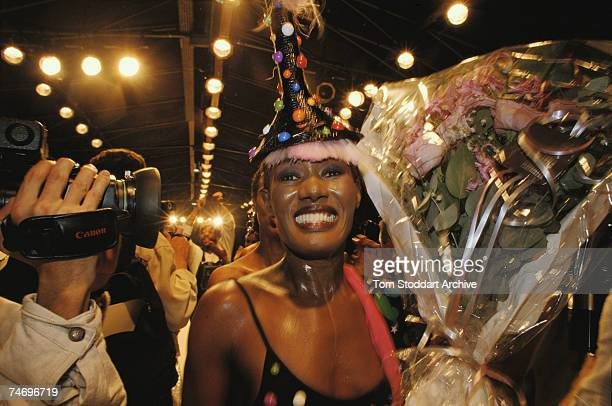 Model and singer Grace Jones wearing an elaborate hat backstage at a Paris fashion show 1989