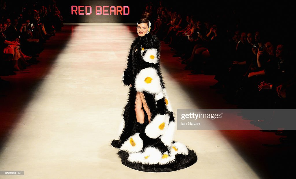 Model and singer Nil Karaibrahimgil walks the runway at the Red Beard by Tanju Babacan show during Mercedes-Benz Fashion Week Istanbul Fall/Winter 2013/14 at Antrepo 3 on March 12, 2013 in Istanbul, Turkey.