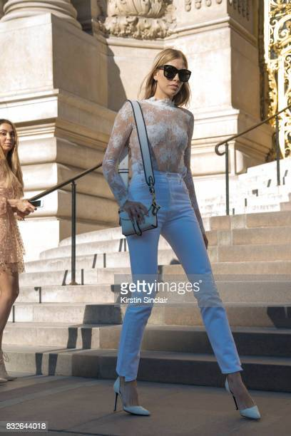 Model and Socialite Lena Perminova wears a white lace top and white jeans and shoes day 2 of Paris Haute Couture Fashion Week Autumn/Winter 2017 on...