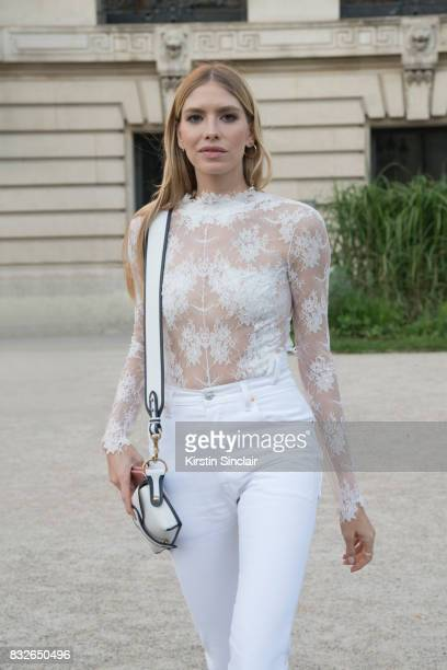 Model and Socialite Lena Perminova wears a white lace top with white jeans and a Dior bag day 2 of Paris Haute Couture Fashion Week Autumn/Winter...