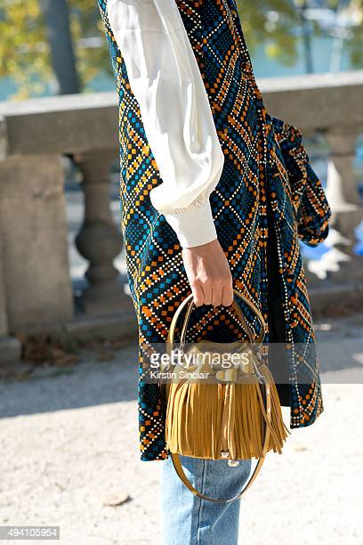 Model and Stylist Clara Racz wears a vintage top and jacket Levi jeans and a Mango bag on day 3 during Paris Fashion Week Spring/Summer 2016/17 on...