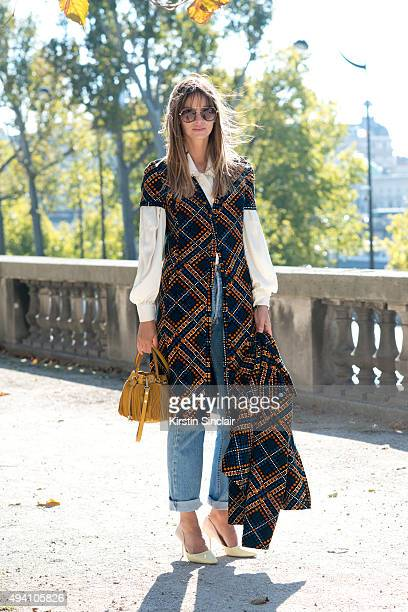 Model and Stylist Clara Racz wears a vintage top and jacket Levi jeans Zara shoes and a Mango bag and sunglasses on day 3 during Paris Fashion Week...