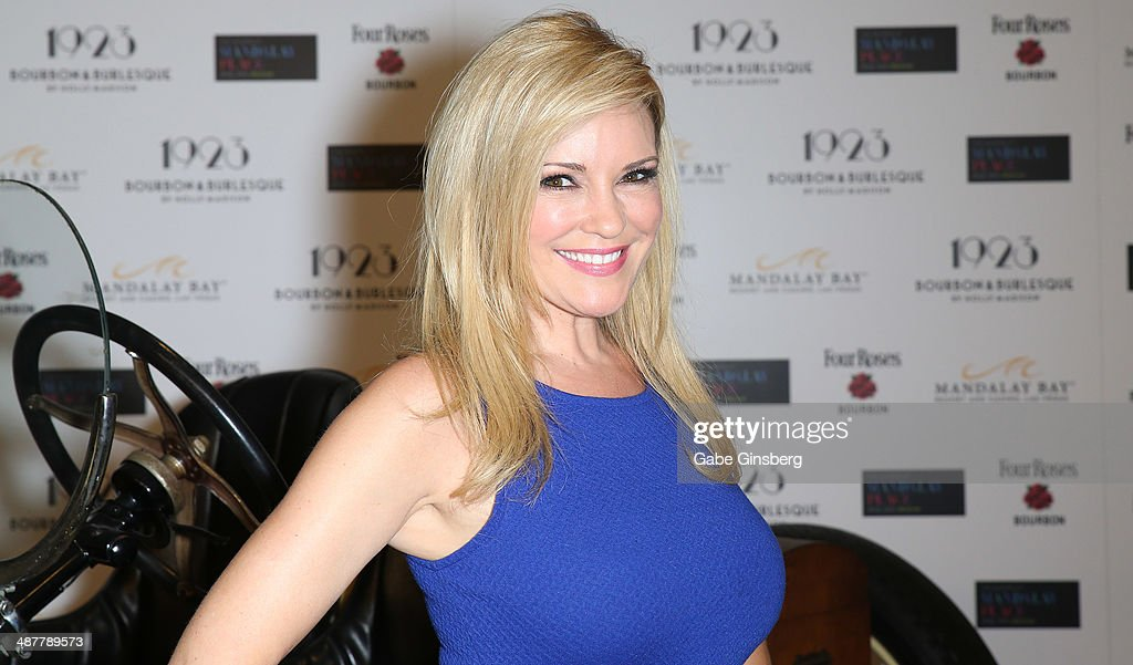 Model and television personality <a gi-track='captionPersonalityLinkClicked' href=/galleries/search?phrase=Bridget+Marquardt&family=editorial&specificpeople=539138 ng-click='$event.stopPropagation()'>Bridget Marquardt</a> poses in front of a 1923 Ford Model T racing car during the grand opening of 1923 Bourbon & Burlesque by Holly Madison at the Mandalay Bay Resort and Casino on May 1, 2014 in Las Vegas, Nevada.