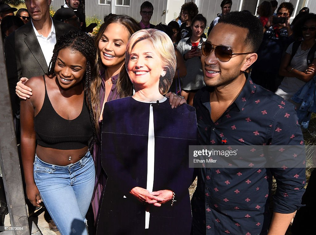Model and television personality Chrissy Teigen and singer/songwriter John Legend pose with a cardboard cutout of Democratic presidential nominee...