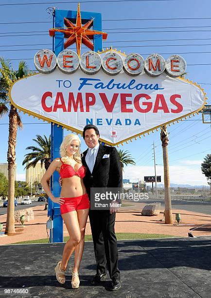 Model and television personality Holly Madison and entertainer Wayne Newton appear at the 'Welcome to Fabulous Las Vegas' sign during the launch...