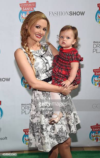 Model and television personality Holly Madison and her daughter Rainbow Aurora Rotella kick off the Adventure to Santa experience at the Fashion Show...