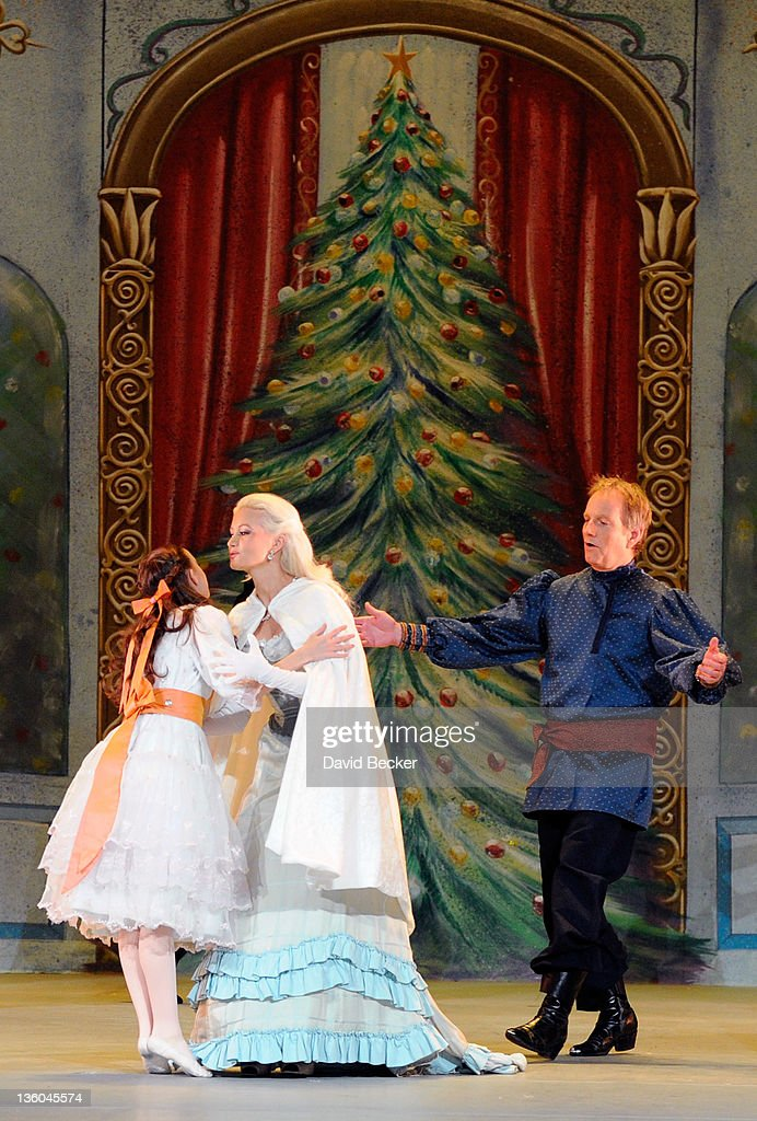 Model and television personality Holly Madison (C) appears as a guest performer in Nevada Ballet Theatre's production of 'The Nutcracker' with Jaime Gallagher (R) at the Theatre des Arts at the Paris Las Vegas on December 17, 2011 in Las Vegas, Nevada.