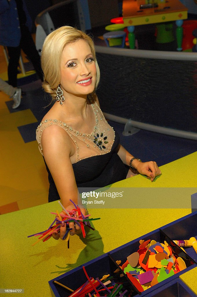 Model and television personality <a gi-track='captionPersonalityLinkClicked' href=/galleries/search?phrase=Holly+Madison&family=editorial&specificpeople=227275 ng-click='$event.stopPropagation()'>Holly Madison</a> appears at the Discovery Children's Museum opening at The Smith Center for the Performing Arts Campus on March 1, 2013 in Las Vegas, Nevada.