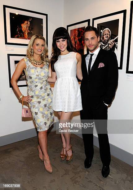 Model and television personality Holly Madison model Claire Sinclair and singer/television personality Josh Strickland appear at the grand opening of...