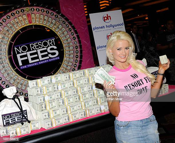 Model and television personality Holly Madison poses with a stack of money at the Planet Hollywood Resort Casino to promote the elimination of resort...