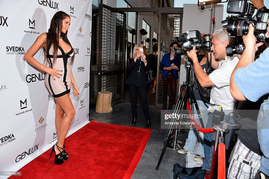Model and television personality Nabilla Benattia arrives at the Genlux Magazine release party with Erika Christensen at Sofitel Hotel on August 29, 2013 in Los Angeles, California.