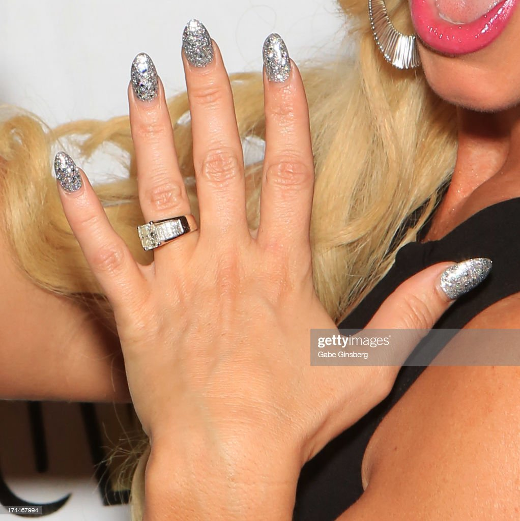Model and television personality Nicole 'Coco' Austin (nails detail) arrives at the 'Zowie Bowie Late Night' show at Bally's Las Vegas on July 25, 2013 in Las Vegas, Nevada.