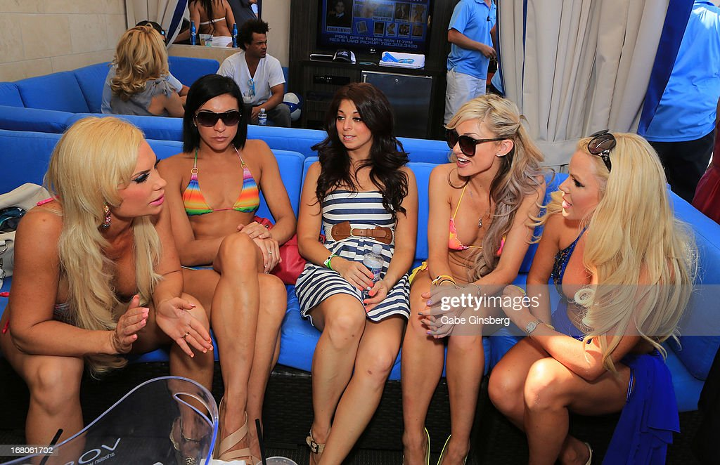 Model and television personality Nicole 'Coco' Austin, Michelle DiTerlizzi, Paula Caselton, DJ model Amie Rose and DJ model Colleen Shannon hang out and talk at the Sapphire Pool & Day Club grand opening party on May 4, 2013 in Las Vegas, Nevada.