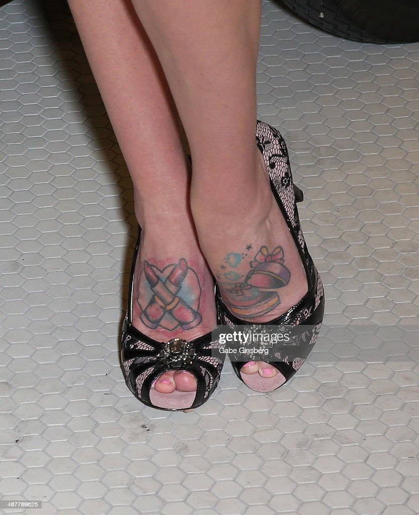 Model and television personality Sabina Kelley (shoes, tattoos detail) attends the grand opening of 1923 Bourbon & Burlesque by Holly Madison at the Mandalay Bay Resort and Casino on May 1, 2014 in Las Vegas, Nevada.