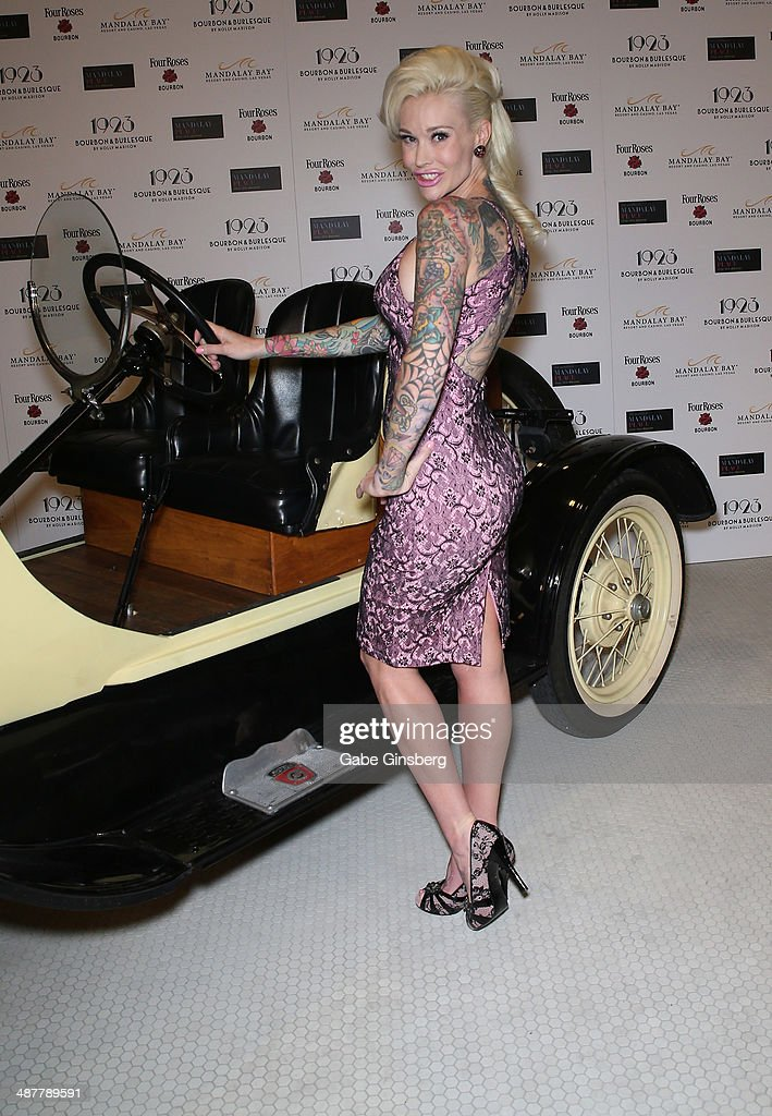 Model and television personality Sabina Kelley poses in front of a 1923 Ford Model T racing car during the grand opening of 1923 Bourbon & Burlesque by Holly Madison at the Mandalay Bay Resort and Casino on May 1, 2014 in Las Vegas, Nevada.
