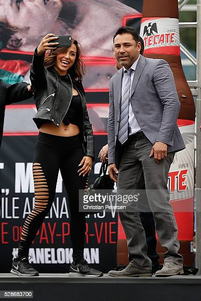 Model and trainer Ana Cheri takes a selfie with former professional boxer and founder of Golden Boy Promotions Oscar De La Hoya on stage during their...