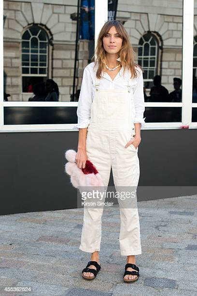Model and TV Presenter Alexa Chung is wearing Birkenstock sandals and Chanel necklace on day 1 of London Collections Women on September 12 2014 in...