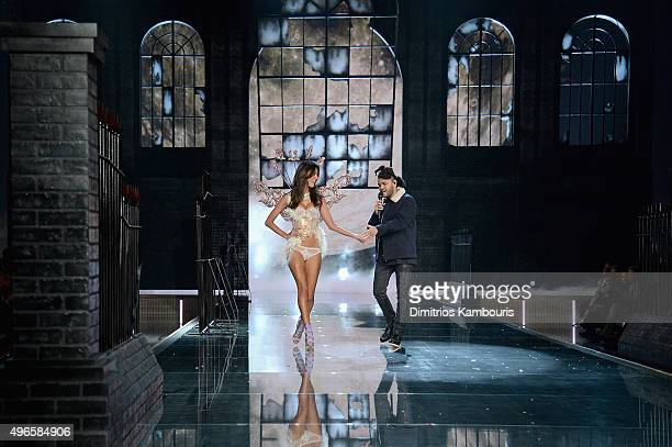 Model and Victoria's Secret Angel Alessandra Ambrosio from Brazil walks the runway while Singer The Weeknd performs during the 2015 Victoria's Secret...
