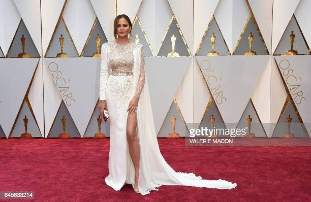 US model and wife of John Legend Chrissy Teigen arrives on the red carpet for the 89th Oscars on February 26 2017 in Hollywood California / AFP /...