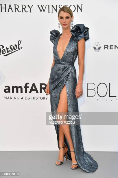 US model Angela Lindvall poses as she arrives for the amfAR's 24th Cinema Against AIDS Gala on May 25 2017 at the Hotel du CapEdenRoc in Cap...
