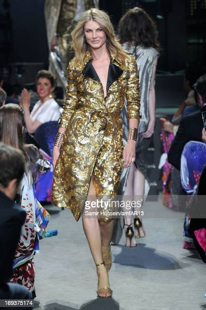 Model Angela Lindvall walks during the fashion show runway as part of amfAR's 20th Annual Cinema Against AIDS during The 66th Annual Cannes Film...