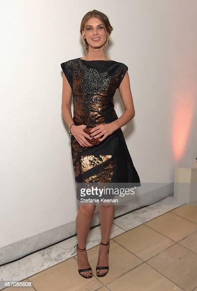 Model Angela Lindvall wearing Early Fall 2014 New Dark Grey Bronze Laminated Print Cloquet Dress Rust Intreccio Impero Ayers Knot and Nero Smooth...