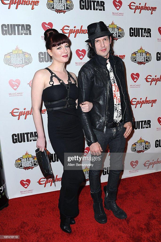 Model Angela Ryan (L) and musician Curse Mackey (R) arrive at the Guitar World's Rock & Roll roast of Zakk Wylde at City National Grove of Anaheim on January 19, 2012 in Anaheim, California.
