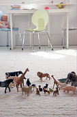 model animals on child's bedroom floor