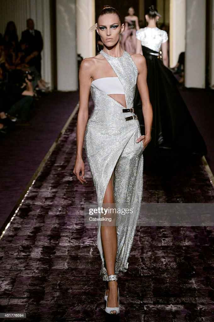 Model Anja Rubik walks the runway at the Atelier Versace Autumn Winter 2014 fashion show during Paris Haute Couture Fashion Week on July 6 2014 in...