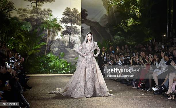 Model Anna Cleveland walks the runway during the Elie Saab Spring Summer 2016 show as part of Paris Fashion Week on January 27 2016 in Paris France