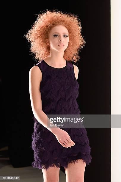 Model Anna Ermakova is seen backstage ahead of the Riani show during the MercedesBenz Fashion Week Berlin Autumn/Winter 2015/16 at Brandenburg Gate...