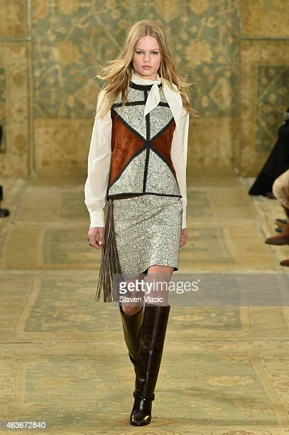 Model Anna Ewers walks the runway at the Tory Burch fashion show during MercedesBenz Fashion Week Fall 2015 at 583 Park Avenue on February 17 2015 in...