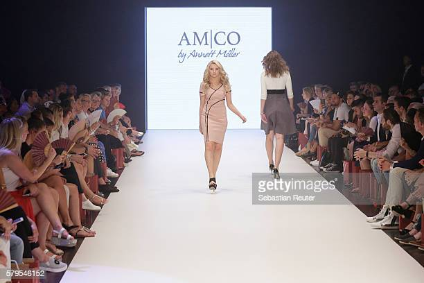 Model Anna Hiltrop and Alana Siegel walk the runway for AMCO by Annett Moeller as part of the Platform Fashion Selected show during Platform Fashion...