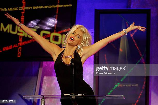 Model Anna Nicole Smith announces the performance by Kanye West during the 32nd Annual 'American Music Awards' at the Shrine Auditorium November 14...