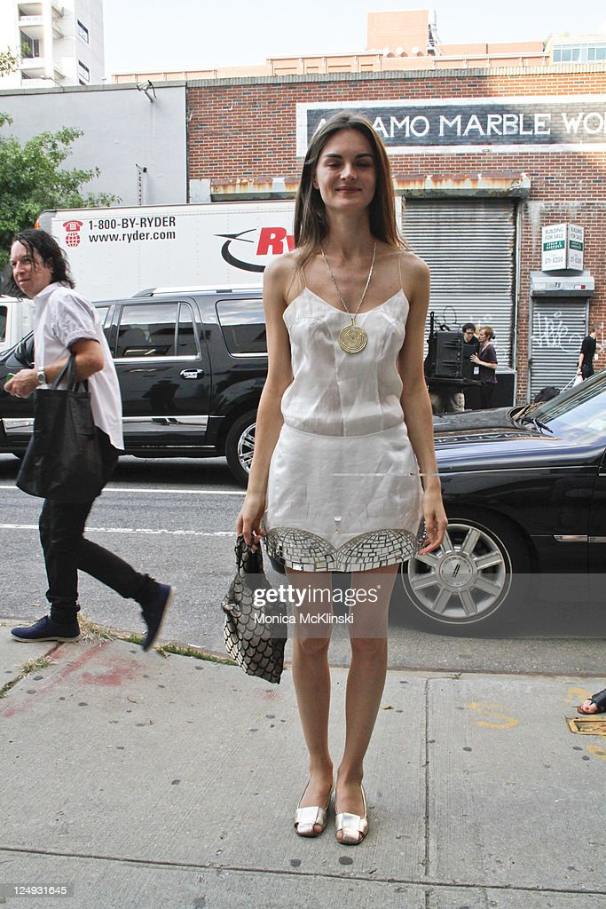 Model <a gi-track='captionPersonalityLinkClicked' href=/galleries/search?phrase=Anouck+Lepere&family=editorial&specificpeople=779132 ng-click='$event.stopPropagation()'>Anouck Lepere</a> wearing an Oliver Theysken dress, an artisan necklace, Steve Weisel flats and a Repose purse departs the Theyskens' Theory Showing at Center 548 in Manhattan during Spring 2012 Fashion Week on September 13, 2011 in New York City.
