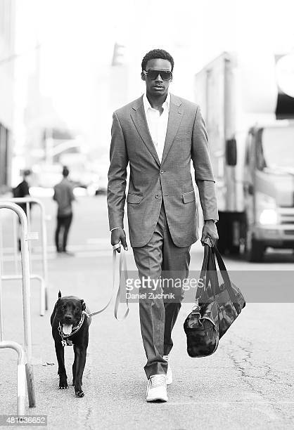 Model Anthony Ruffin age 25 from New York is seen outside the Ricardo Seco show wearing a Dolce and Gabbana suit and Adidas shoes with Naomi the dog...