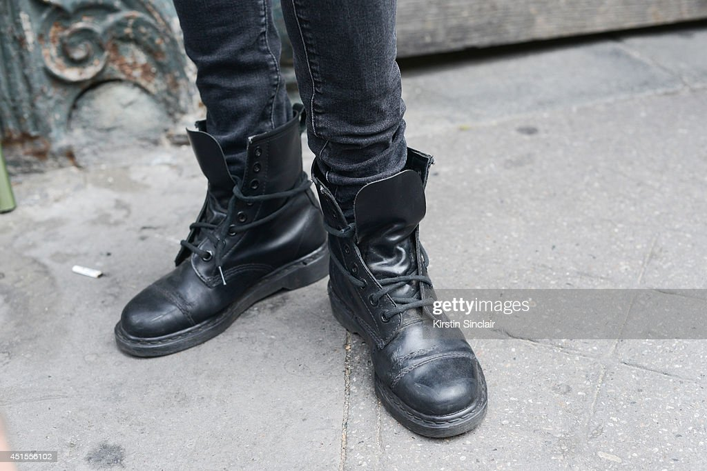 Model Anton Lisin wearing H and M jeans and Doc Martins boots on day 1 of Paris Collections Men on June 25 2014 in Paris France