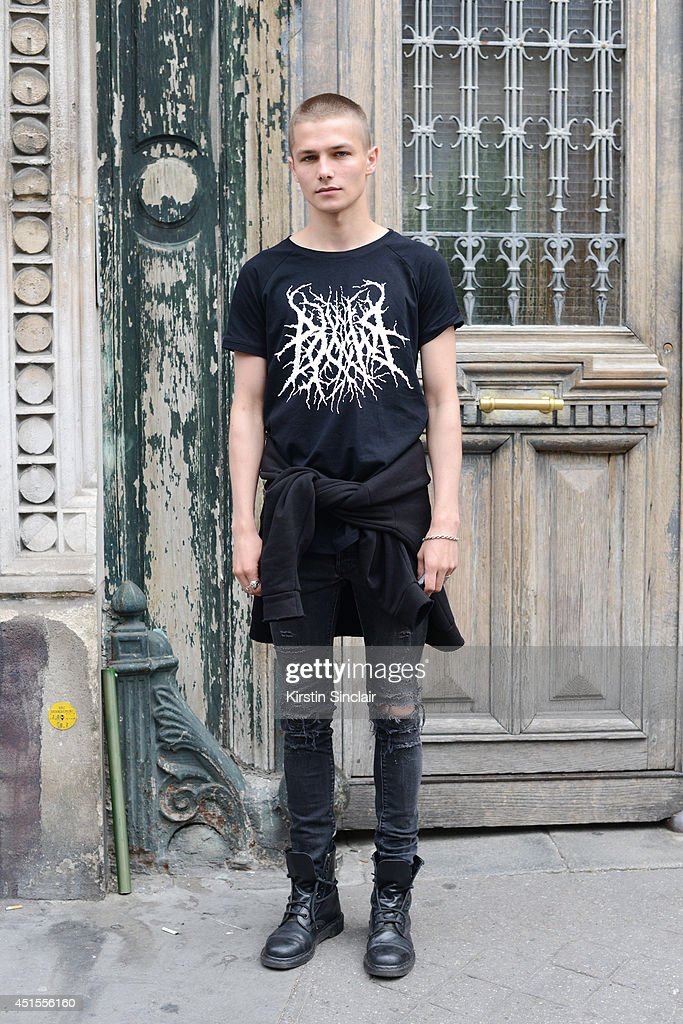 Model Anton Lisin wearing H and M jeans, Anton Lisin T-shirt and Doc Martins boots on day 1 of Paris Collections: Men on June 25, 2014 in Paris, France.